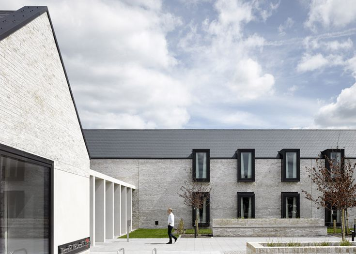 Gabled brick buildings surround quiet courtyards to create a comforting environment for families of sick children at this hospital facility in Glasgow