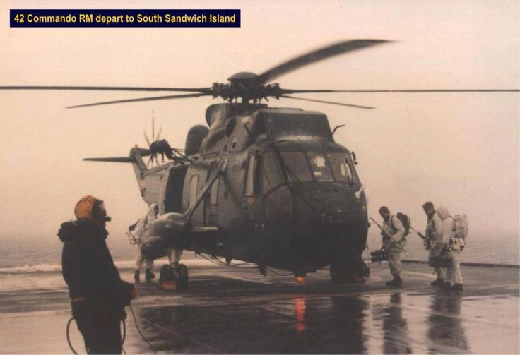 Marines of the M company 42 Commando board a Sea King for departure to South Sandwich island, Falklands.