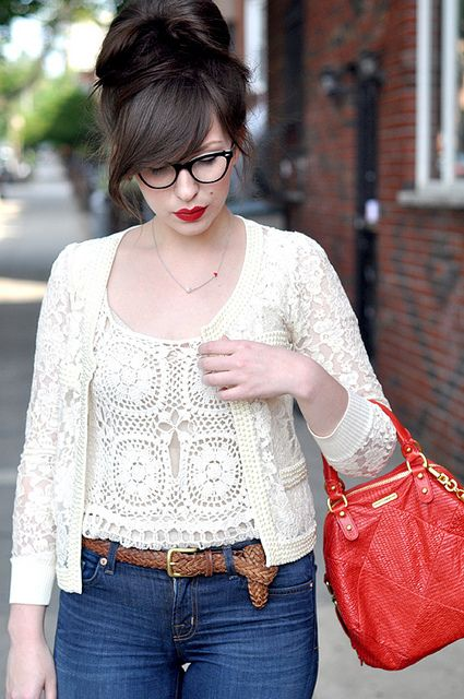 high hair. side swept bangs. glasses. crochet top. lips. purse...