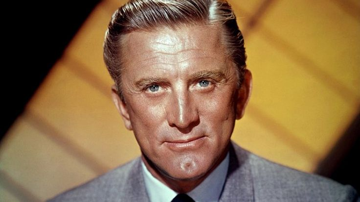 Kirk Douglas, one of the few remaining survivors of Hollywood's golden age and possessor of the most famously dimpled chin in cinema, celebrates his 100th birthday on Friday. Born Issur Danielovitch into abject poverty in Amsterdam, New York, Douglas, in the classic American immigrant rags to riches story (literally: his father was a ragman), overcame his impoverished early life to become a major player in the movie world, both as an actor and as a powerful, risk-taking  producer.