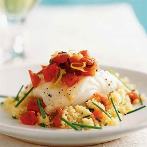 Oven-Roasted Sea Bass with Couscous and Warm Tomato Vinaigrette 346 calories per serving| MyRecipes.com