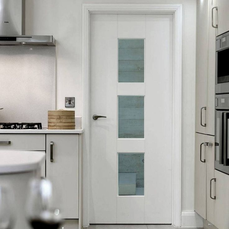 JBK Symmetry Geo White Primed Door with Clear Safety Glass - Lifestyle Image.    #glazeddoors