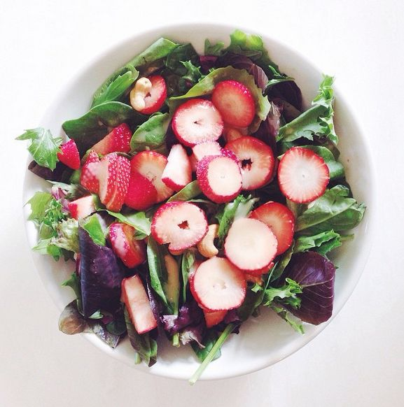 mixed greens with strawberries and cashews, topped with a champagne vinaigrette