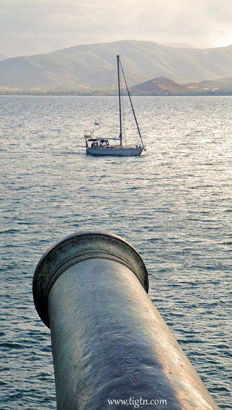 """Yacht """"within range"""" of one of the five canons of the """"Five Brothers"""" bastion on the fortifications of #Akronafplia Castle in #Nafplio - #Greece"""