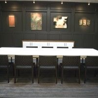 Furniture. Rustic Meeting Room With Rectangular White Wooden Table And Black Chairs Also Black Wooden Wall Panel With Modern Office Furniture And Office Tables. The Most Desirable Meeting Room Table For Office Equipment
