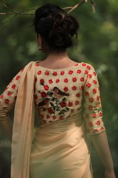 PRODUCT DESCRIPTION: Featuring a warm morning sunshine colored pure chiffon saree with a single climbing red rose vine on the pallu. It comes with an unstitched blended raw silk blouse with handcrafted red rose motifs and sparrows on branches on the sleeves and back, and an unstitched matching satin petticoat fabric. NOTES: Colours may appear slightly different due to photography lighting conditions and your monitor display settings.  SHIPPING/DELIVERY: This product will be shipped to you…