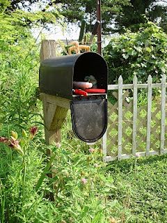 Use A Mailbox To Hold Your Gardening Tools