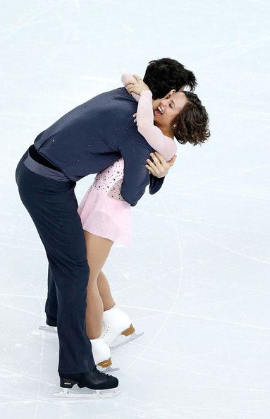 Meagan Duhamel and Eric Radford of Canada compete in the Figure Skating Pairs Short Program during the Sochi 2014 Winter Olympics at Iceberg...