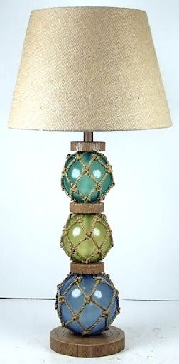 glass floats lamp-- this lamp would match my floating glass that's hanging by my living room curtains :)