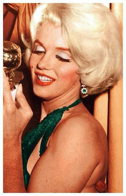 Marilyn Monroe with another Golden Globe award. 1962
