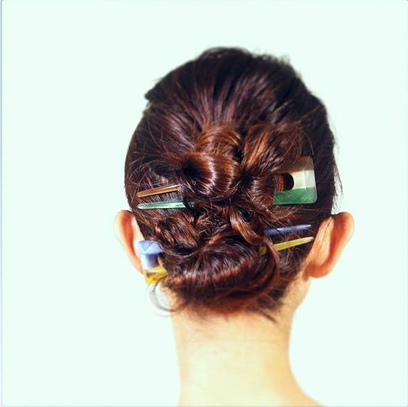 If you have very thick hair try doing a double knot with these racer striped acrylic hairpins.