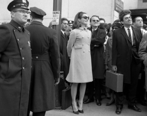 """flawless-jackie: """" Jackie Kennedy at the St. Patrick's Day Parade in New York City, 1966 (on her tippy toes!) """""""