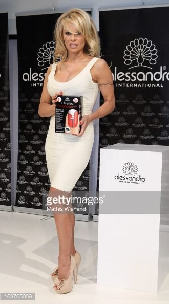 Pamela Anderson presents 'Striplac' nail polish at Beauty Fair Duesseldorf on March 15 2013 in Dusseldorf Germany