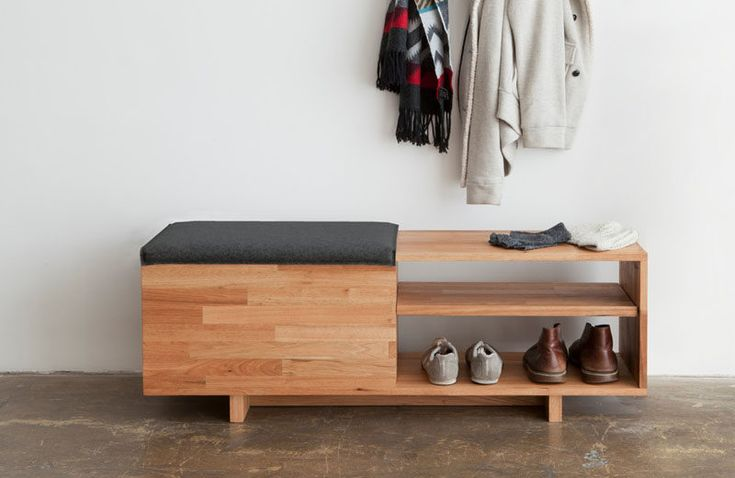 Entryway Design Ideas - 3 Different Styles Of Entryway Benches // A simple bench like this one is great in small spaces where storage is lacking. Shoes or baskets fill the shelves and things you don't use often can be tossed into the storage compartment under the soft seat.