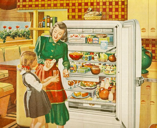 This was a particularly big fridge in those days (aka, the 1940s). Love how well stocked it is - right down to the desserts already in their serving dishes.