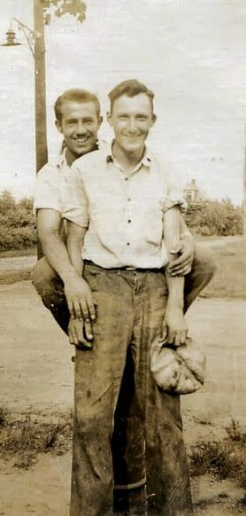 """vintage photo: Since the men in this photo are unknown, it's pretty much impossible to tell it they were a gay couple or just """"good friends."""" Most photographs of gay couples were eventually destroyed by horrified family members. But for every photo that is mistakenly identified as gay, thousands more were burned or torn into pieces to keep a family secret."""