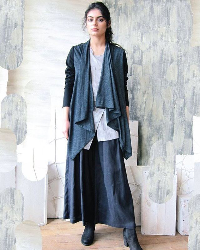 Designed and made in Melbourne, Victoria, the Charcoal Merino Kadie Drape Jacket is the trans-seasonal spring time version of our signature Kadie Drape Jacket. This truly versatile and unisex piece adds a layer of warmth and style to your outfit and its mix of sharp angles and soft drape adds an elegant touch to your ensemble.  Shop the look at www.thedresscollective.com ✔️ #thedresscollective #australianmade #jude #designbyjude #unisexfashion #ethicalfashion
