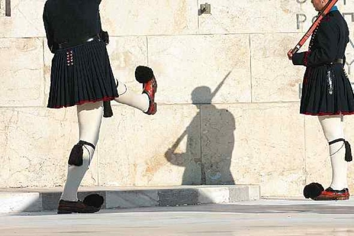 The Evzones - Tomb of the Unknown Soldier in Athens. They are military men that constitute the ceremonial Presidential Guard. At any one time there are 180 serving Evzones. Minimum height is 1.87m to even be considered for training to become one. 50% of trainees do not get through the drill. The fustanella (kilt-like garment) is made of 30m of white cotton, pleated 400 times to mark the 400 years of Ottoman occupation...