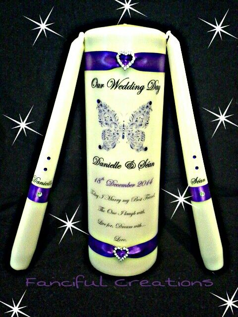 Cadbury purple with butterfly. All custom designed candles.  https://m.facebook.com/personalised.candles.for.all.occasions