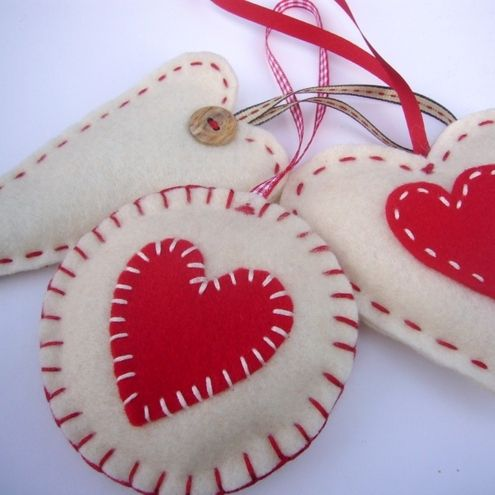 handsewn decorations made in soft felt and gently padded. The set includes a round decoration measuring approx. 9cm in width; a heart decoration measuring approx. 9cm in width; and a long heart measuring approx. 14 cm long.    Use them to add some stylish, yet traditional charm to your Christmas tree. Alternatively you could hang them from doors, handles or windows.