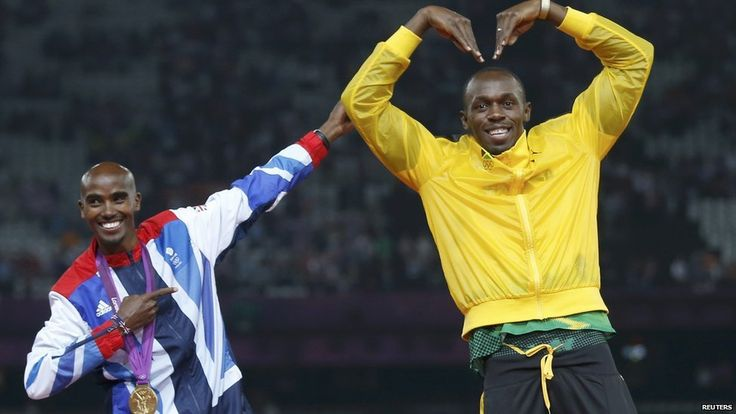 Mo Farah and Usain Bolt doing each other's trademark poses just after both winning their respective Olympic races.