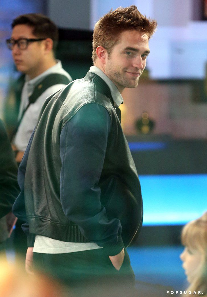 Pin for Later: This Week's Can't-Miss Celebrity Pics!  Robert Pattinson smirked before his appearance on Good Morning America on Tuesday in NYC.
