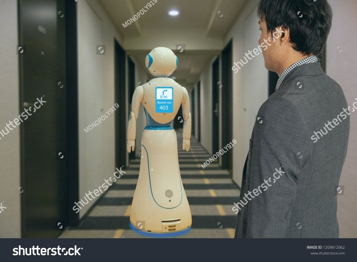 smart hotel in hospitality industry 4.0 technology concept, robot butler (robot assistant) use for greet arriving guests, deliver customer, items to r…