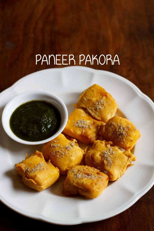 paneer pakora recipe with step by step photos - these tasty paneer pakoras are crisp from outside and soft from inside.    paneer pakoda is a popular pakora variety. at my in law's home, whenever we make pakoras,