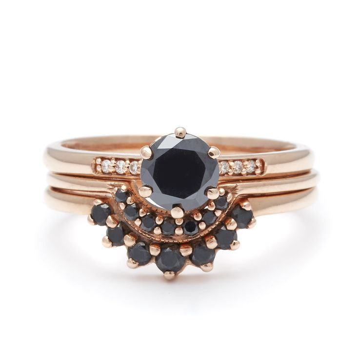 The Hazeline Suite No.12 features a tiering of black diamonds set into warm toned rose gold, a delicate half carat Hazeline, Tiny Crescent, and Grand Tiara of t