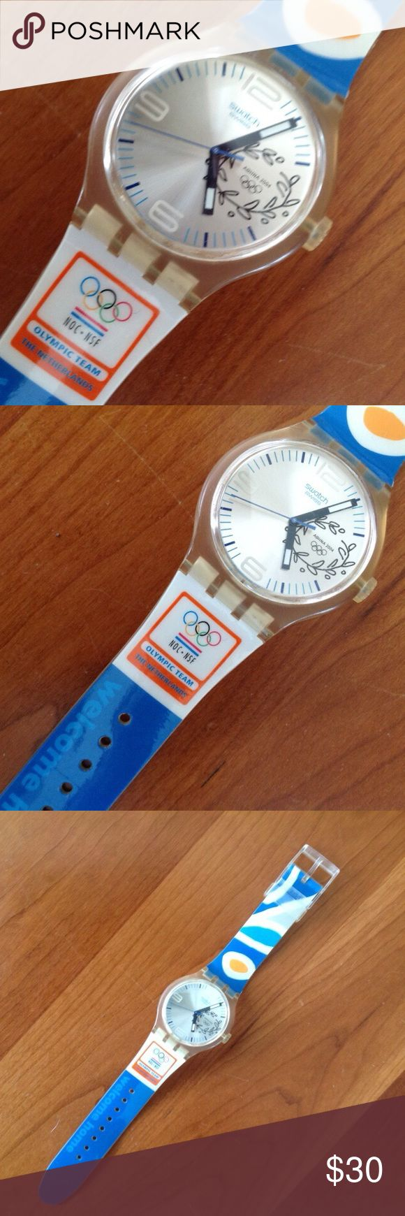 """Limited edition Olympic swatch Vintage Swatch 2004 Athens Olympics  Fan Apparel The Netherlands Welcome Home Watch 10"""" long, 1 1/2"""" diameter watch face. Excellent condition.  Sold without battery.   The Athens Olympic NOC for the Netherlands has the code SUDK106M. Only 900 pieces made: 450 pieces were given to athletes and coaches and 450 pieces were sold to collectors. Swatch Accessories Watches"""