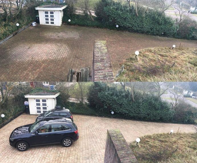 Pressure washing a driveway, looks great!