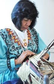 Eveline Steele (Choctaw) of Broken Bow, OK weaving a river cane basket