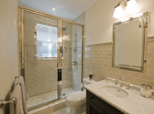 SOme great tile ideas for the upstairs bathroom (which is currently long, narrow and dreary) - I like the continuation of the tile here, and the openness of the glass doors. I am considering a white subway tile, with penny tiles on the floor, and chocolate brown and lime green accent colors.