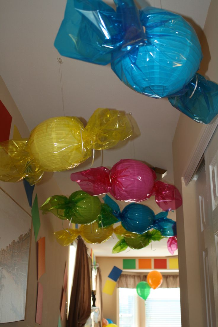 Giant hanging candies for Candy Land theme party....make each one out of a rubber ball and each kid gets to take one home