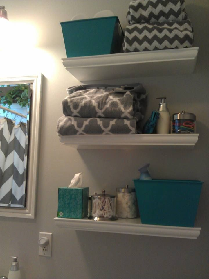 "Towels from HomeGoods and TJMaxx. Puffs plus box of tissues. ContainerStore for the three small containers.  WestElm - gray Chevron shower curtain. Sherwin Williams-Passive # 7064;  Home Good towels, Home Good Q-tip container, 24"" floating shelves from Home Depot, Marshalls teal bath rug, Softsoap container. Received help from Kevin Grace from HGTV DesignStar at West Elm Lincoln Park, Chicago"