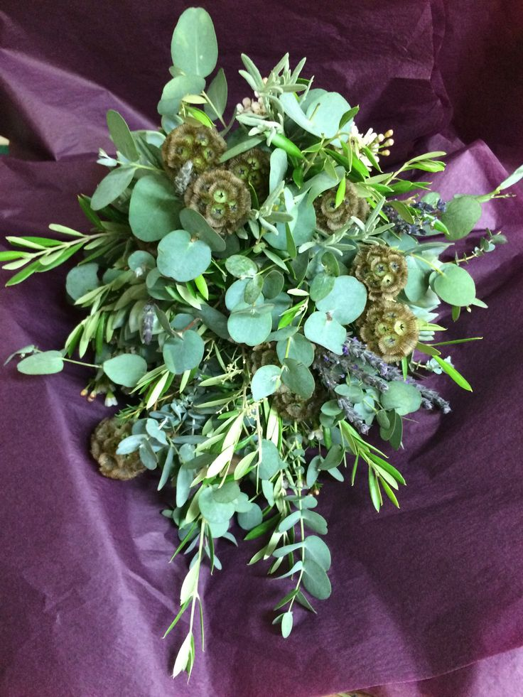 For the bride that didn't like flowers.. we made a bouquet with all eucalyptus and olive foliage and to give more interest added Scabiosa pods and dried lavender with a few sprigs of Wax Flower - she was very happy and we also made a lovely matching headdress