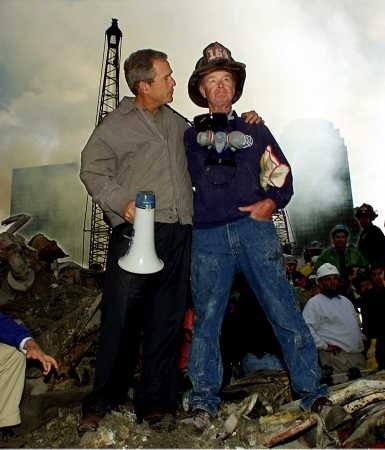 History: President George W. Bush and retired firefighter Bob Beckwith atop the rubble days after 9/11.