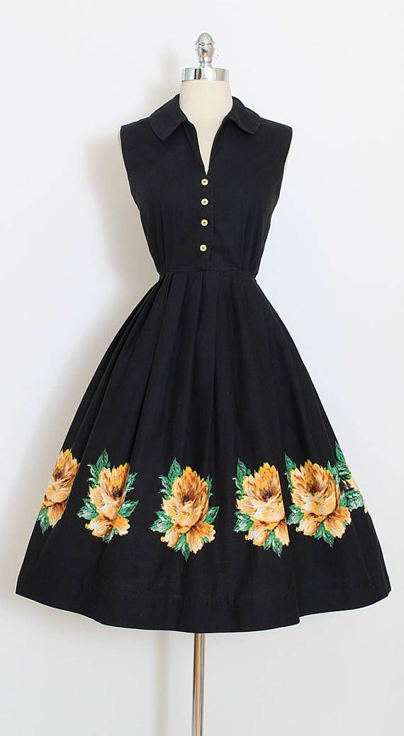 ➳ vintage 1950s dress  * black cotton shirtdress * painted yellow rose border print * metal side zipper * button front bodice  condition | excellent - normal cotton wash wear  fits like xs/s  length 43 bodice 16 bust 36-38 waist 26-27 hem allowance 2.5  some clothes may be clipped on dress form to show best fit for appropriate size.  ➳ shop http://www.etsy.com/shop/millstreetvintage?ref=si_shop  ➳ shop policies http://www.etsy.com/shop/millstr...