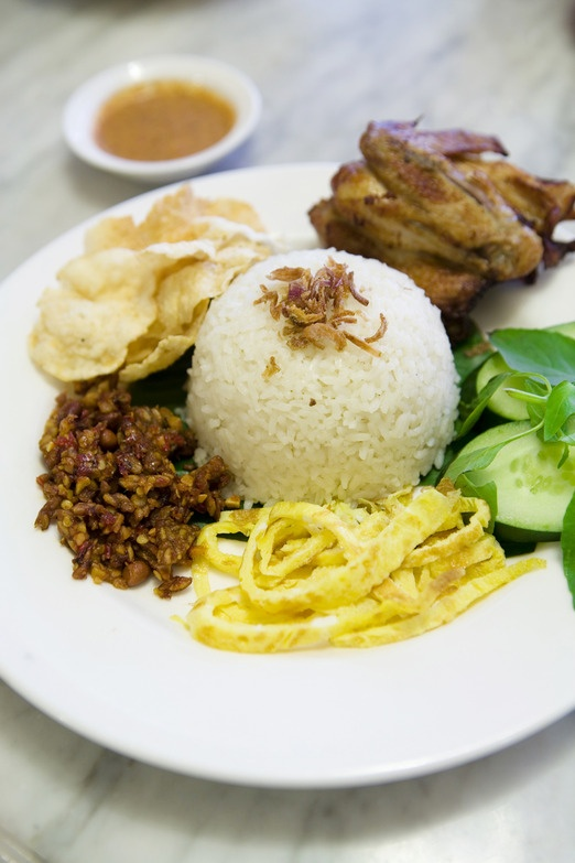 There is likely to be a stall serving nasi uduk in almost every corner of Jakarta. Photo by Arif Budiman.