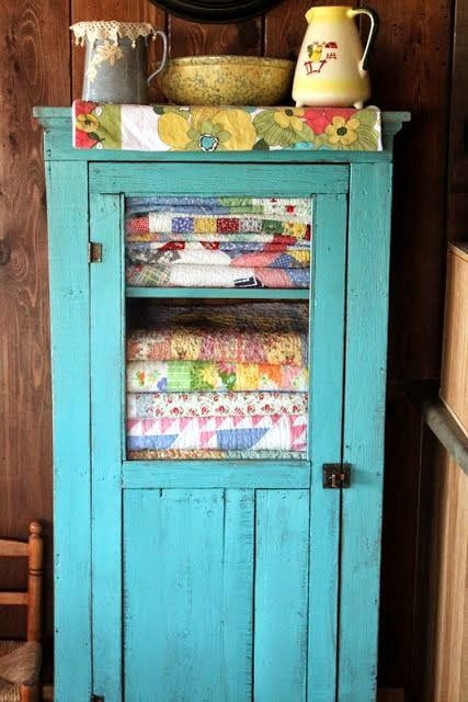 I do love the colour of this vintage linen cupboard. Yummy!
