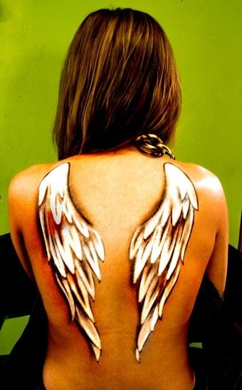 Love the white ink...angel wings tattoo want angel wings around my dad's name I have tattooed on my back in memory of my mommy