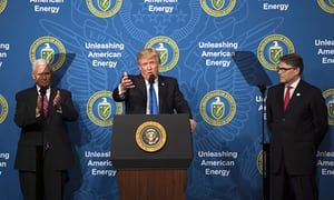 President Donald Trump, joined by Vice President Mike Pence (L) and Energy Secretary Rick Perry, delivers remarks at the Unleashing American Energy event at the Department of Energy in Washington, D.C. on June 29, 2017.