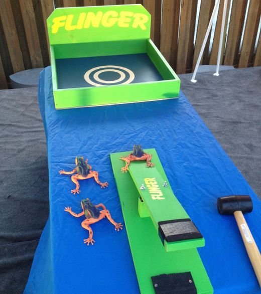 Fling rubber frogs into the square... if it lands on the target you get a bag of candy; if it lands inside the box you get a piece of candy! Everyone is a winner!