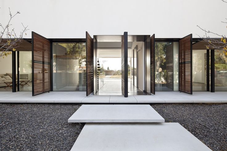 White Walls | Black–Framed Glazing | Operable Timber Battened Screens | Floating Step Detail