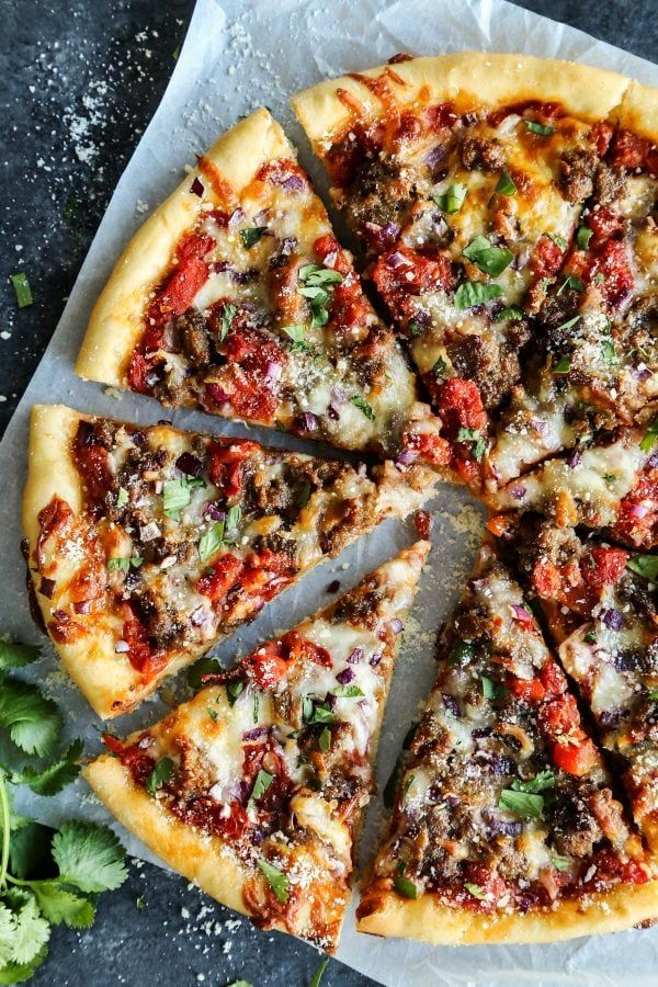 Skillet Pizza with Sausage and Chili Garlic Tomato Sauce from afarmgirlsdabbles.com