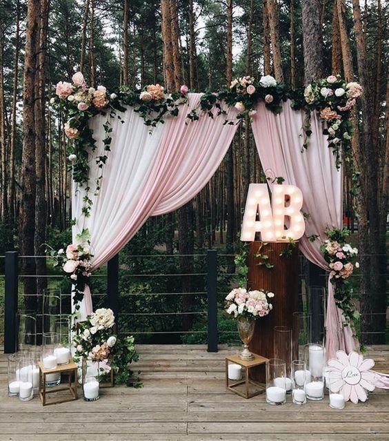 rustic country pink wedding arch / http://www.himisspuff.com/wedding-initials-letters-decor-ideas/3/