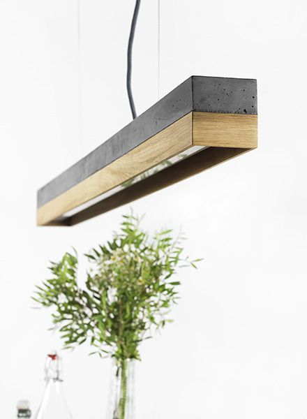 The rectangular pendant lamp [C1]copper is cast from a light grey concrete. It…