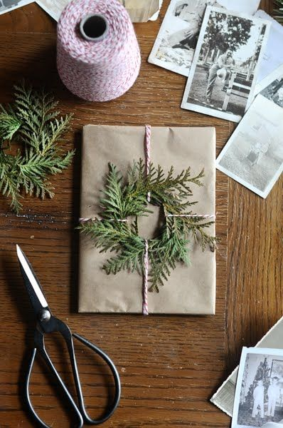 ~pretty way to wrap a christmas gift - bakers string and fir to make a mini wreath.