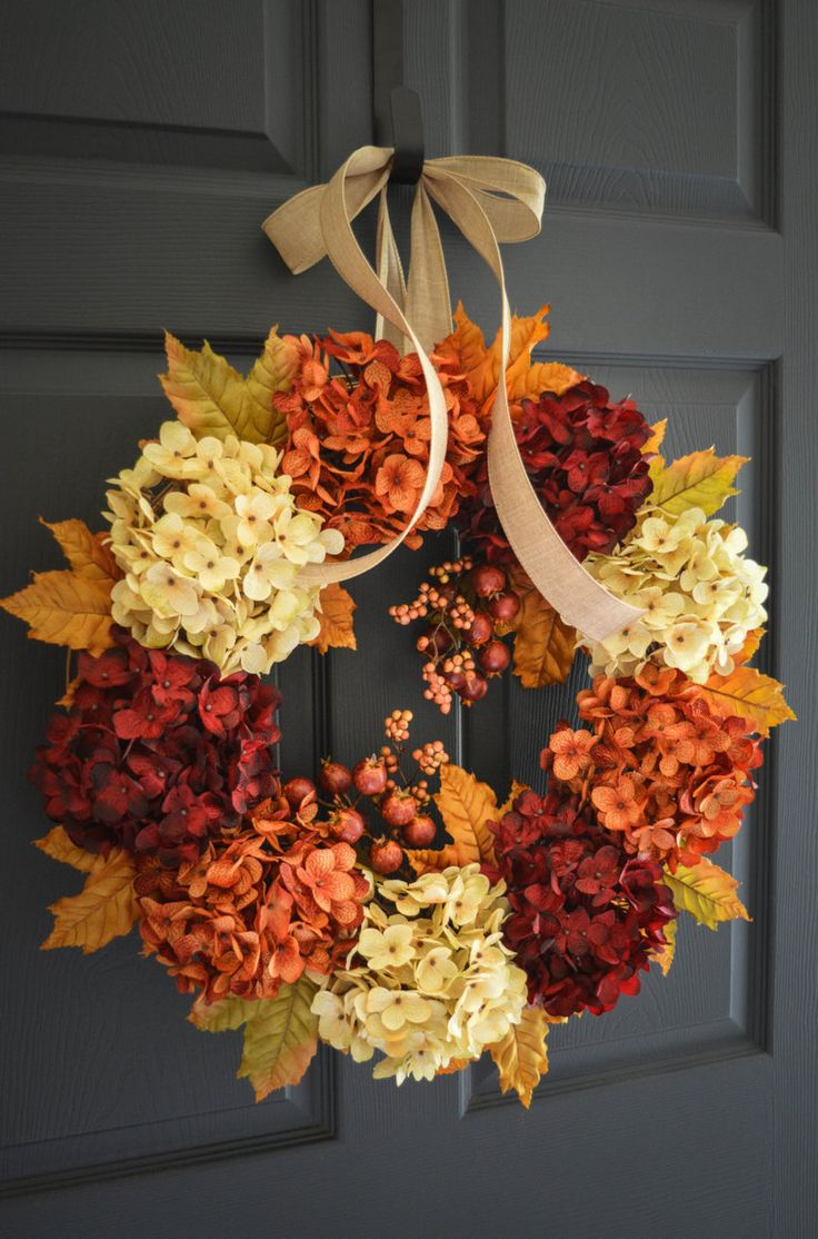 Fall outdoor wreath design handcrafted with wonderful combination  artificial hydrangeas colors with faux pomegranate berries and varying  autumn leaves.