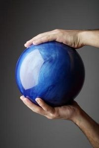 How to repurpose a bowling ball as a gazing-ball substitute for garden art. Cover with stained glass or pre-cut glass...marbles, etc.